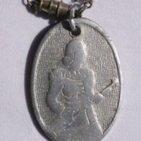 Necklace - Woman With Gun (front)