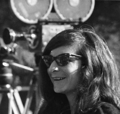 photo of roz payne with movie camera behind her